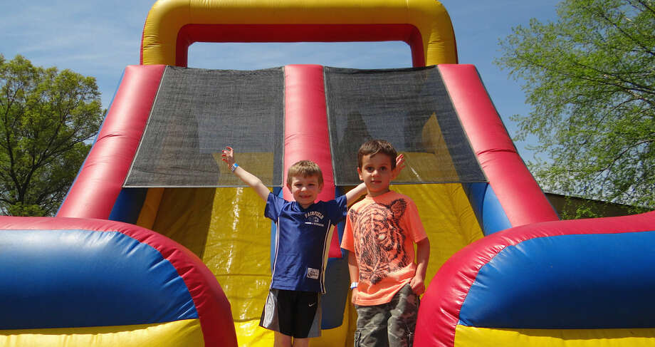 Matthew Ferrando, 6, and Nico Gonzalez, 5, bounced in the sunshine on an inflatable slide at Holland Hill Elementary School's Family Fun Day.