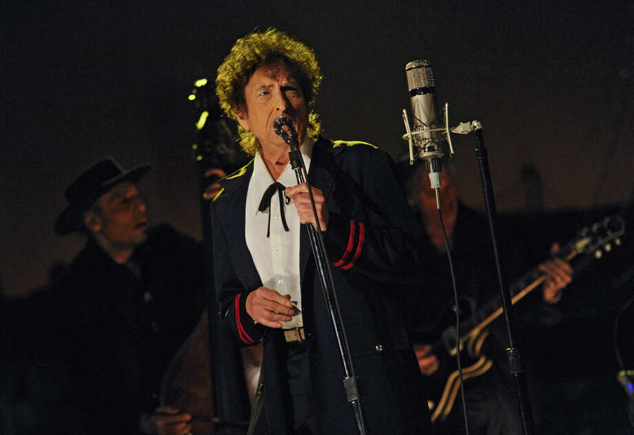 "In this photo provided by CBS, musical guest Bob Dylan performs on the set of the ""Late Show with David Letterman,"" Tuesday, May 19, 2015 in New York. (Jeffrey R. Staab/CBS via AP) MANDATORY CREDIT; NO ARCHIVE; NO SALES; FOR NORTH AMERICAN USE ONLY"