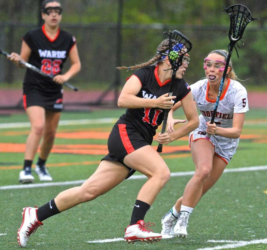 Ridgefield's Sterling Walkup (5) stays with Fairfield-Ward's Amanda Orvis (11) in the girls lacrosse game between Fairfield-Ward and Ridgefield high school, on Friday night, May 13, 2016, at Ridgefield High School, in Ridgefield, Conn.