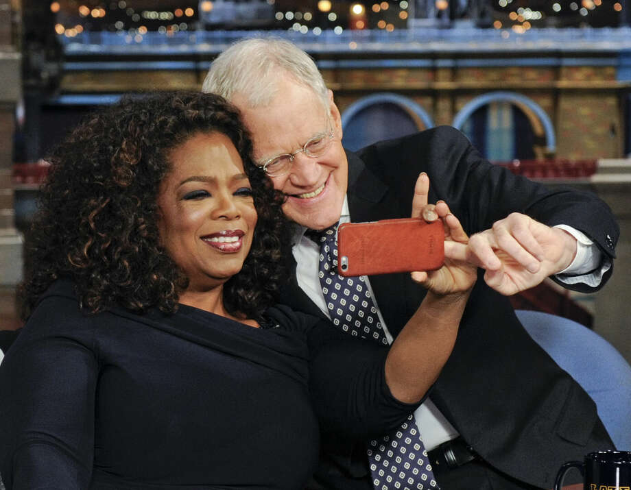 "In this photo provided by CBS, host David Letterman makes a selfie with Oprah Winfrey during Oprah's final appearance on the ""Late Show with David Letterman,"" Friday May 15, 2015 in New York. (Jeffrey R. Staab/CBS via AP) MANDATORY CREDIT, NO SALES, NO ARCHIVE, FOR NORTH AMERICAN USE ONLY"