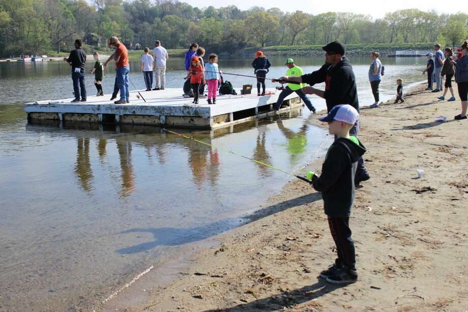 Kyle Grasley, 8 in front, fishes with his father Dean at The Danbury Fish & Game Association's 45th annual Kid's Fishing Derby that was held at Candlewood Town Park in Danbury on Sat., May 14, 2016.