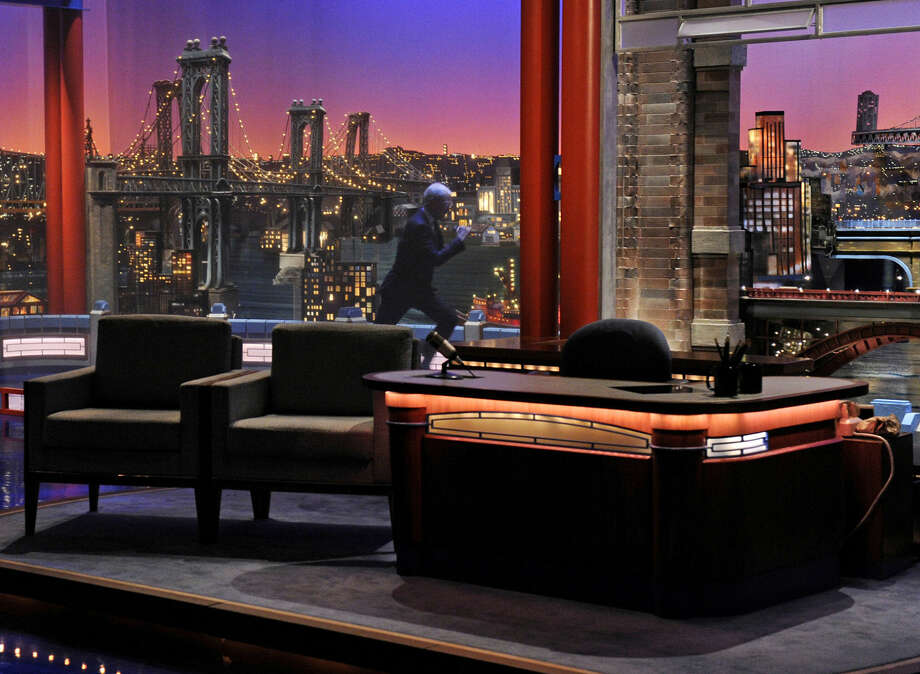 "In this image released by CBS, David Letterman runs across the stage for the start of the show during a taping of his final ""Late Show with David Letterman,"" Wednesday, May 20, 2015 at the Ed Sullivan Theater in New York. After 33 years in late night television, 6,028 broadcasts, nearly 20,000 total guest appearances, 16 Emmy Awards and more than 4,600 career Top Ten Lists, David Letterman is retiring. (Jeffrey R. Staab/CBS via AP)"