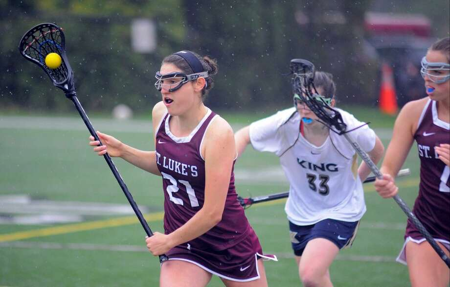 St. Luke's Emma Powless (21), brings the ball up field against King in a girls lacrosse game at St. Luke's School in New Canaan on May 13, 2016. St. Luke's defeated King 14-12.