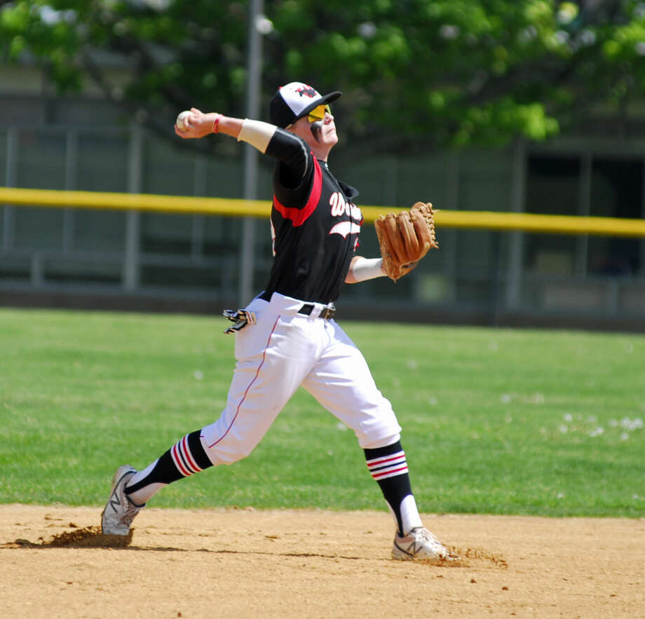 Warde shortstop Jack Myers throws to first base during a game against Staples Saturday.