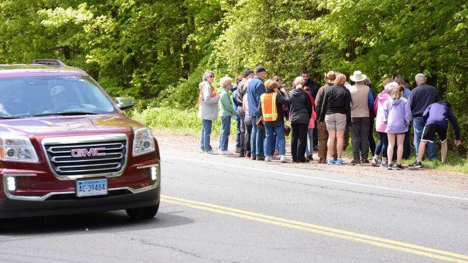 A group of locals met at the Goodie Shop in New Fairfield to walk a proposed walking trail along route 37 by the Margerie Resevoir on Sunday May 15, 2016.