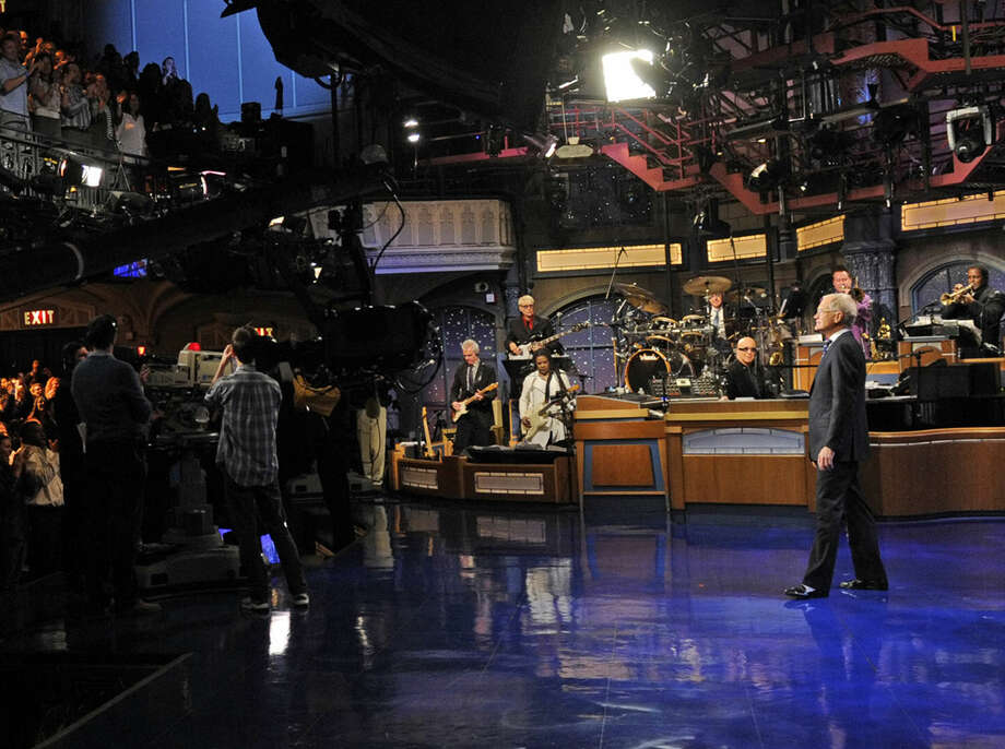 "In this image released by CBS, David Letterman receives a standing ovation during the taping of his final ""Late Show with David Letterman,"" Wednesday, May 20, 2015 at the Ed Sullivan Theater in New York. After 33 years in late night television, 6,028 broadcasts, nearly 20,000 total guest appearances, 16 Emmy Awards and more than 4,600 career Top Ten Lists, David Letterman is retiring. (Jeffrey R. Staab/CBS via AP)"