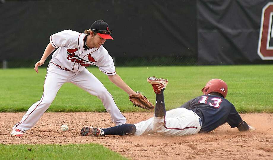 Greenwich second baseman Daniel Coombs lays down a tag without the ball on Brien McMahon baserunner Hunter Dumas during a stolen base in Saturday's 7-1 Cardinals FCIAC baseball win in Greenwich.