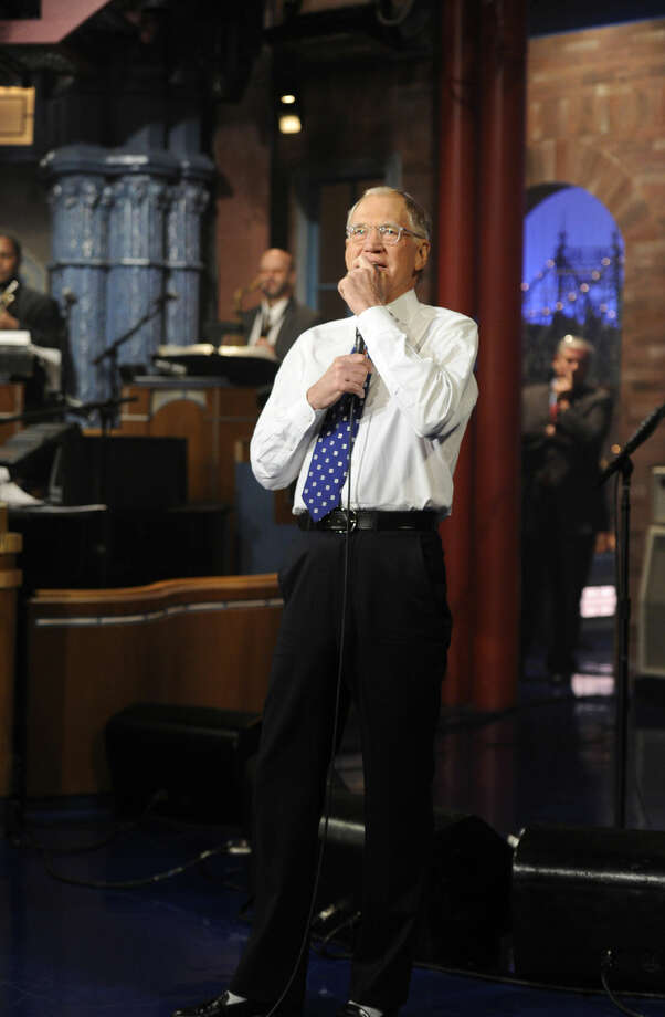 "In this image released by CBS, David Letterman appears during a taping of his final ""Late Show with David Letterman,"" Wednesday, May 20, 2015 at the Ed Sullivan Theater in New York. After 33 years in late night television, 6,028 broadcasts, nearly 20,000 total guest appearances, 16 Emmy Awards and more than 4,600 career Top Ten Lists, David Letterman is retiring. (Jeffrey R. Staab/CBS via AP)"