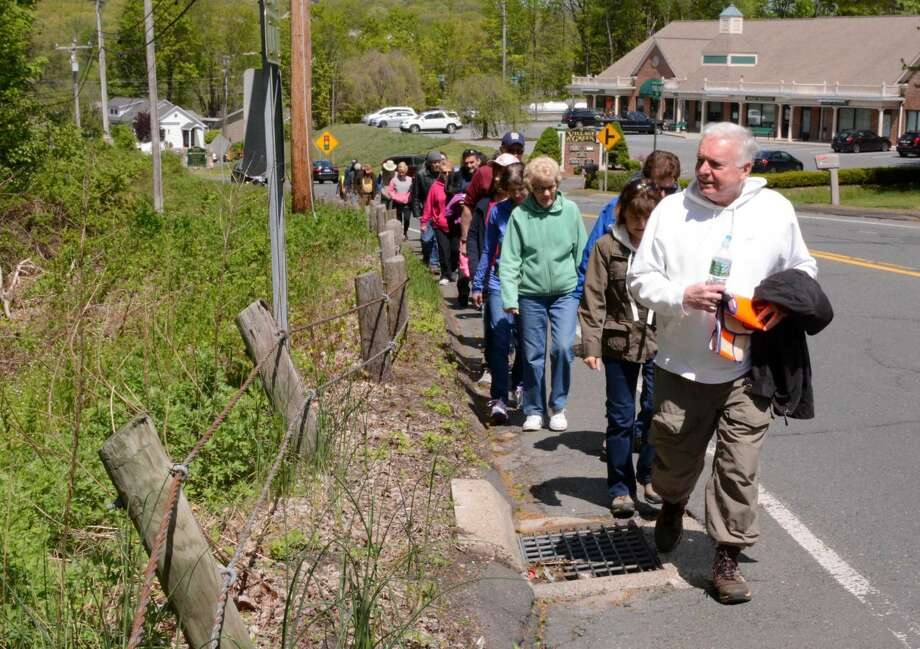 Peter Hearn from New Fairfield leads a group of locals along a proposed trail on Route 37 next to Margerie Manor on Sunday May 15, 2016.