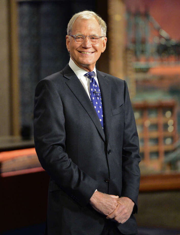 "In this photo provided by CBS, David Letterman hosts his final broadcast of the ""Late Show with David Letterman,"" Wednesday May 20, 2015 in New York. After 33 years in late night television, 6,028 broadcasts, nearly 20,000 total guest appearances, 16 Emmy Awards and more than 4,600 career Top Ten Lists, David Letterman says goodbye to late night television audiences. (John Paul Filo/CBS via AP) MANDATORY CREDIT; NO ARCHIVE; NO SALES; NORTH AMERICAN USE ONLY"