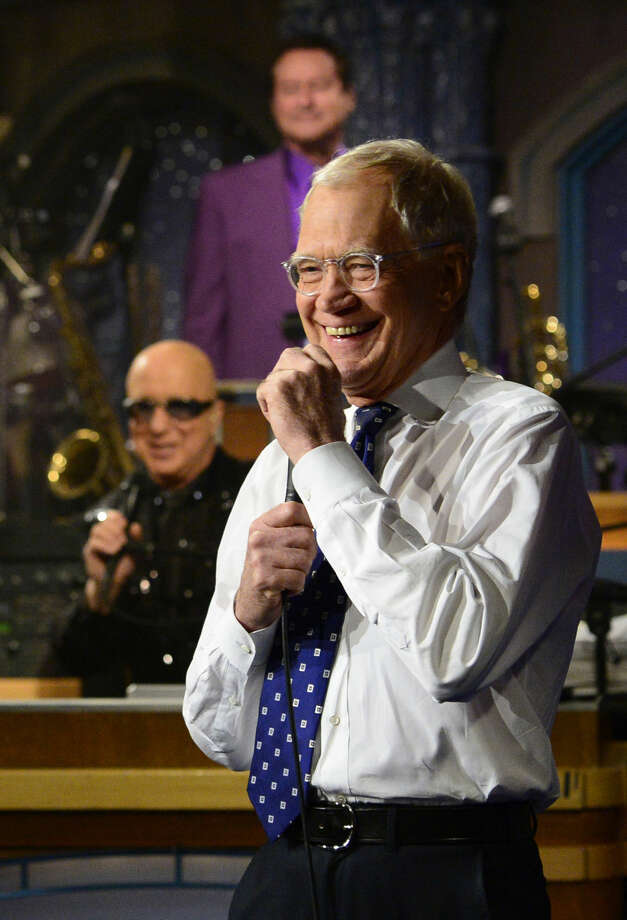 "In this photo provided by CBS, David Letterman hosts his final broadcast of the ""Late Show with David Letterman,"" Wednesday May 20, 2015 in New York. After 33 years in late night television, 6,028 broadcasts, nearly 20,000 total guest appearances, 16 Emmy Awards and more than 4,600 career Top Ten Lists, David Letterman says goodbye to late night television audiences. (John Paul Filo/CBS via AP)"
