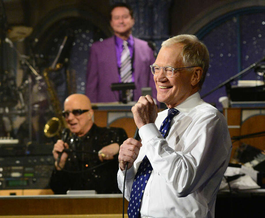 "In this photo provided by CBS, David Letterman appears during a final taping of the ""Late Show with David Letterman,"" Wednesday May 20, 2015 in New York. After 33 years in late night television, 6,028 broadcasts, nearly 20,000 total guest appearances, 16 Emmy Awards and more than 4,600 career Top Ten Lists, David Letterman says goodbye to late night television audiences. (John Paul Filo/CBS via AP) MANDATORY CREDIT; NO ARCHIVE; NO SALES; NORTH AMERICAN USE ONLY"