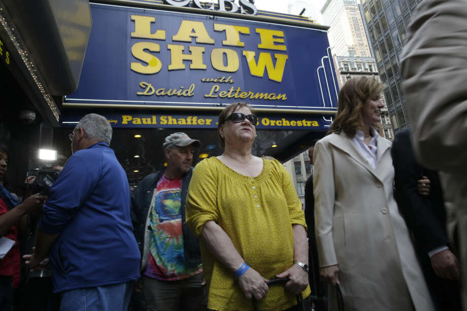 "Audience members leave the final taping of the ""Late Show with David Letterman"" at the Ed Sullivan Theater in New York, Wednesday, May 20, 2015. Letterman signed off Wednesday after 33 years and 6,028 broadcasts of his late-night show. (AP Photo/Mary Altaffer)"
