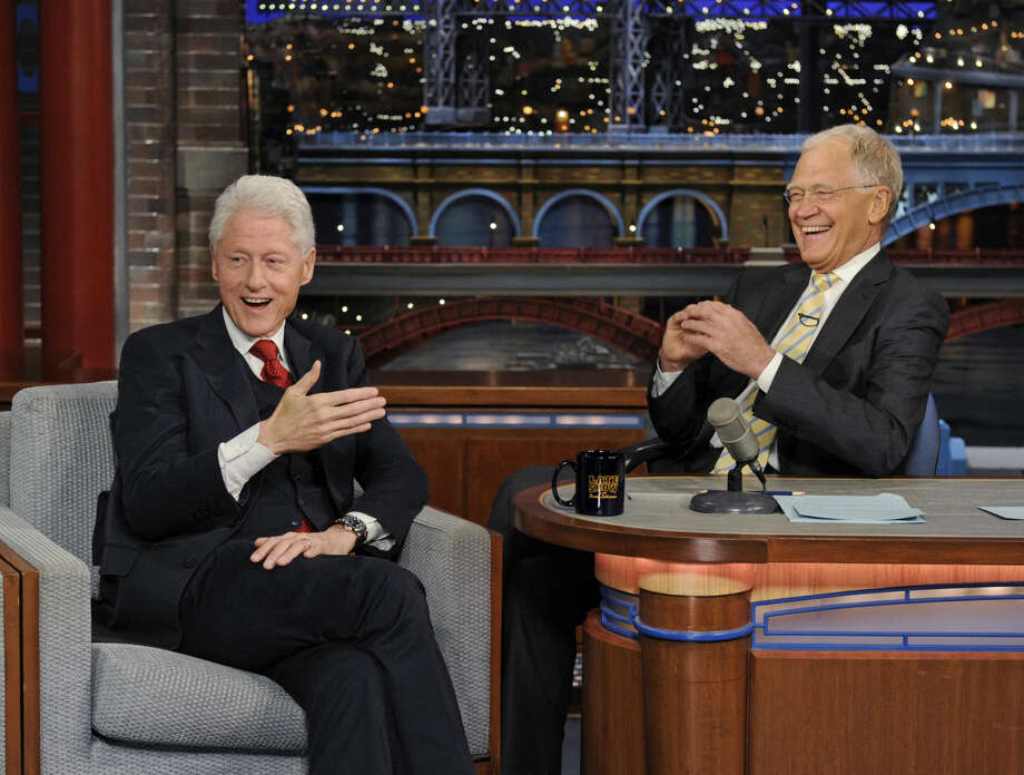 "In this photo provided by CBS, former President Bill Clinton, left, makes his final appearance on the ""Late Show with David Letterman,"" on the CBS Television Network on Tuesday, May 12, 2015, in New York. Letterman, right, will host his final broadcast of the ""Late Show"" on Wednesday, May 20, 2015, on the CBS Television Network. (Jeffrey R. Staab/CBS via AP)"