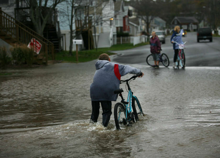 Flooding from Hurricane Sandy on Point Beach Drive in Milford on Monday, October 29, 2012.