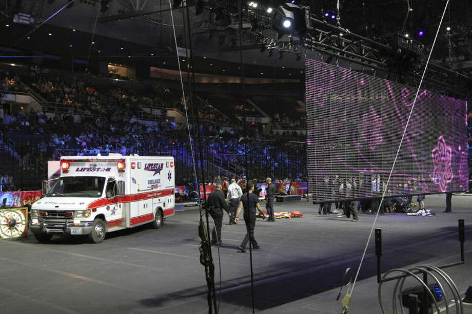 First responders work at the center ring after a platform collapsed during an aerial hair-hanging stunt at the Ringling Brothers and Barnum and Bailey Circus, Sunday, May 4, 2014, in Providence, R.I. At least nine performers were seriously injured in the fall, including a dancer below, while an unknown number of others suffered minor injuries. (AP Photo/Providence Journal, Bob Breidenbach) MANDATORY CREDIT; ONLINE OUT; RHODE ISLAND MEDIA OUT; NO SALES