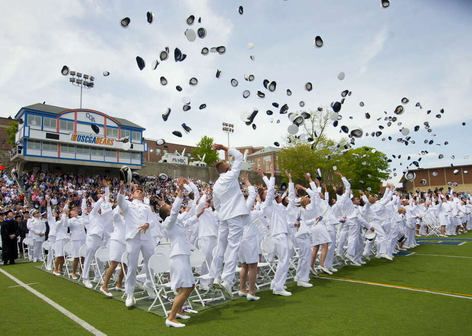 Members of the graduating class of 2015 U.S. Coast Guard Academy throw their hats in the air near the end of their ceremony in New London, Conn., Wednesday, May 20, 2015. (AP Photo/Pablo Martinez Monsivais)