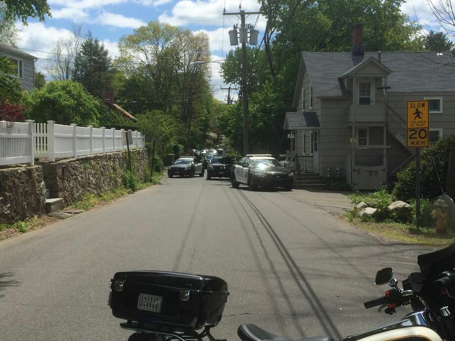 Police have surrounded a home on Richmond Hill Avenue in Westport, Conn. on Monday, May 16, 2016. Officials are in communication with a person inside the house and say at least one of the people in the house has a weapon.