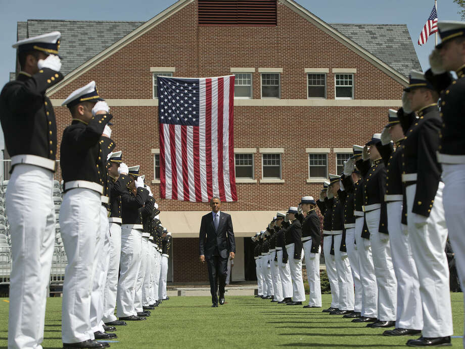 President Barack Obama is introduced at the U.S. Coast Guard Academy in New London, Conn., Wednesday, May 20, 2015, before giving the commencement address. (AP Photo/Pablo Martinez Monsivais)