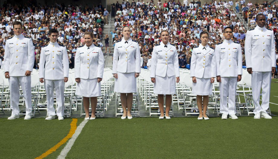 Members of the class of 2015 U.S. Coast Guard Academy stand before taking their seats at graduation ceremonies in New London, Conn., Wednesday, May 20, 2015, where President Barack Obama was to give the commencement address. (AP Photo/Pablo Martinez Monsivais)