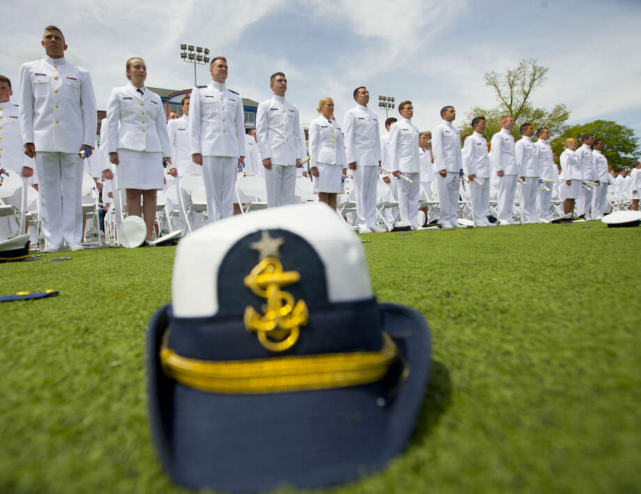 Members of the graduating class of 2015 U.S. Coast Guard Academy stand up from their seats near the end of their ceremony in New London, Conn., Wednesday, May 20, 2015. (AP Photo/Pablo Martinez Monsivais)