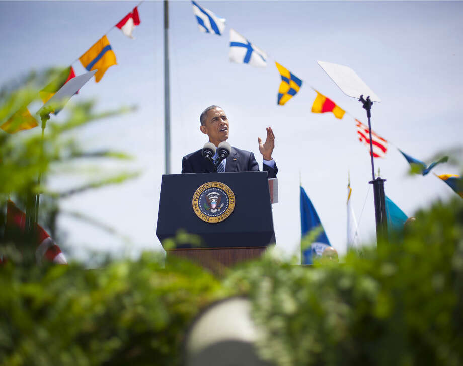 President Barack Obama delivers the commencement address as he attends the U.S. Coast Guard Academy graduation in New London, Conn., Wednesday, May 20, 2015. (AP Photo/Pablo Martinez Monsivais)