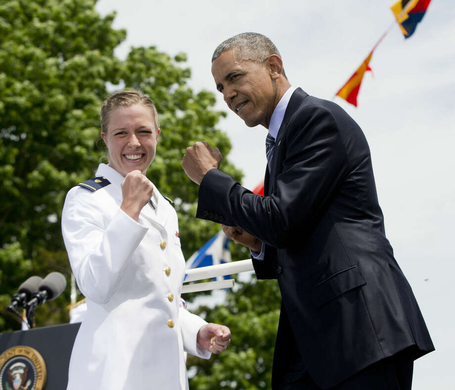 President Barack Obama and Ensign Mary Elizabeth Hazen strike a pose after she received her diploma and commission at the U.S. Coast Guard Academy graduation, Wednesday, May 20, 2015, in New London, Conn. (AP Photo/Pablo Martinez Monsivais)