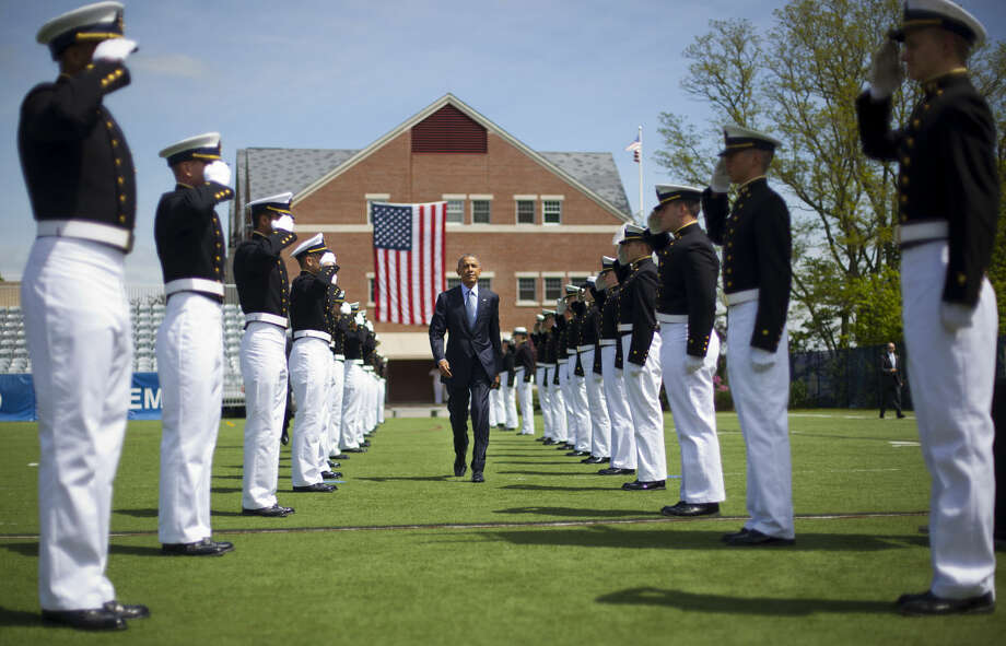 President Barack Obama walks in after being introduced at the U.S. Coast Guard Academy graduation in New London, Conn., Wednesday, May 20, 2015. (AP Photo/Pablo Martinez Monsivais)