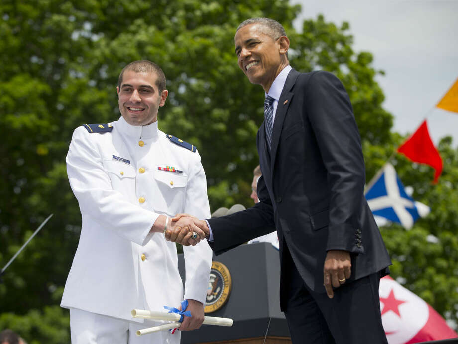 President Barack Obama shakes hands with Ensign George Talakhadze, from the country of Georgia, after he received his diploma and commission, Wednesday, May 20, 2015, at the U.S. Coast Guard Academy graduation in New London, Conn. (AP Photo/Pablo Martinez Monsivais)