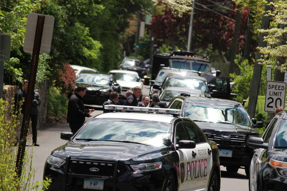 A couple have reportedly agreed to leave their house, ending a tense standoff where police had surrounded a home on Richmondville Avenue in Westport, Conn. on Monday, May 16, 2016. Officials are in communication with a person inside the house and say at least one of the people in the house has a weapon.