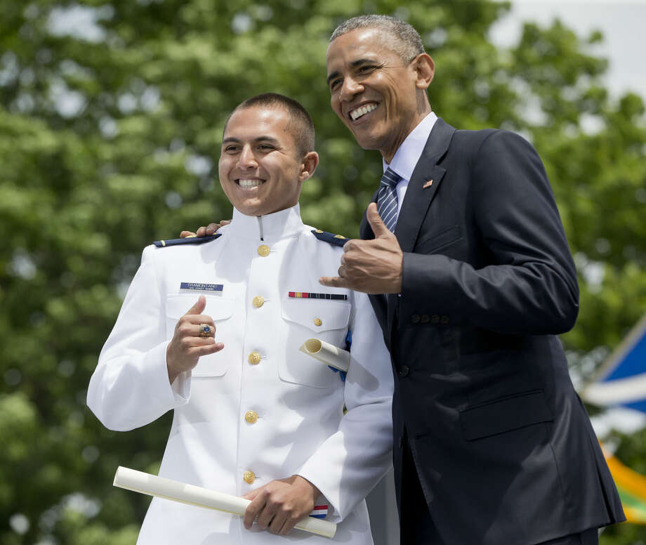"President Barack Obama makes the traditional Hawaiian ""shaka"" greeting sign with Ensign Rocco Michael Kekai Tramontano after he received his diploma and commission at the U.S. Coast Guard Academy graduation, Wednesday, May 20, 2015, in New London, Conn.. (AP Photo/Pablo Martinez Monsivais)"
