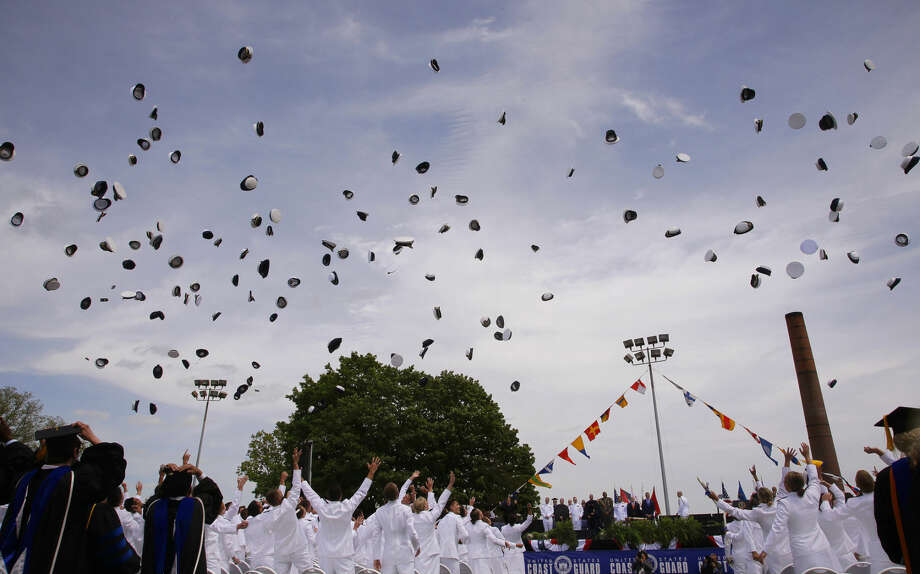 Newly commissioned Ensigns toss their hats into the air at there conclusion of the U.S. Coast Guard Academy's 134th Commencement Exercises, Wednesday, May 20, 2015, in New London, Conn. where President Barack Obama delivered the commencement addressg. (AP Photo/Stephan Savoia)