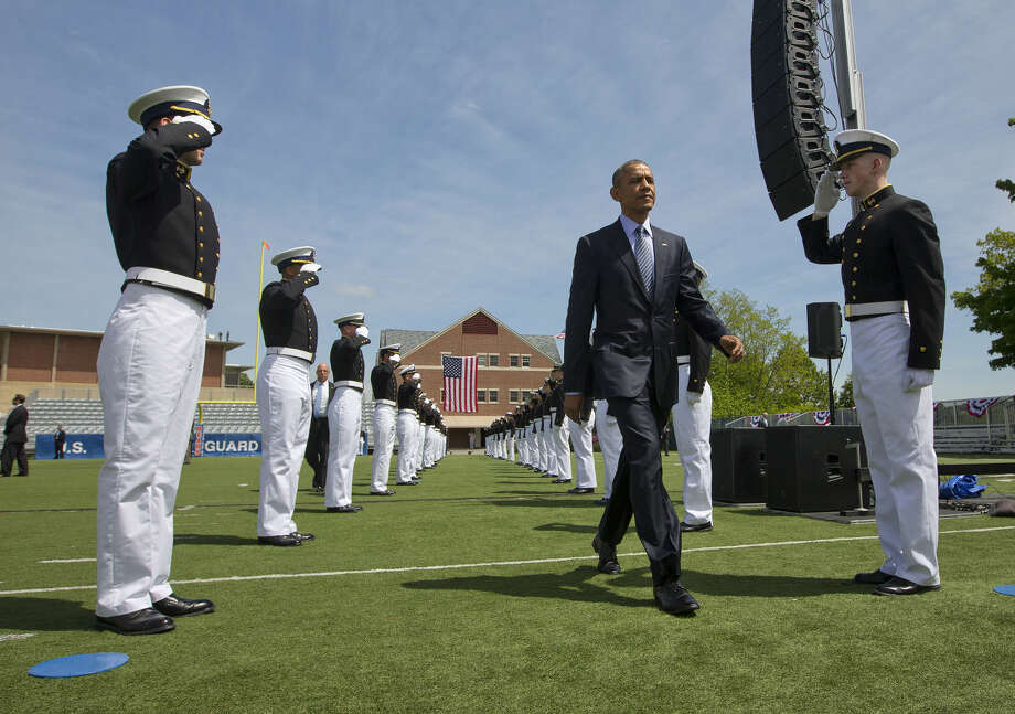 President Barack Obama is introduced at the U.S. Coast Guard Academy graduation in New London, Conn., Wednesday, May 20, 2015, before giving the commencement address. (AP Photo/Pablo Martinez Monsivais)