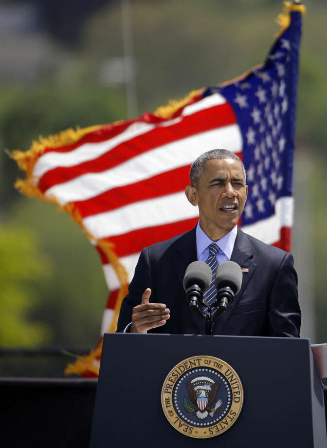 President Barack Obama delivers the commencement address during the United States Coast Guard Academy's 134th Commencement Exercises, Wednesday, May 20, 2015, in New London, Conn. (AP Photo/Stephan Savoia)
