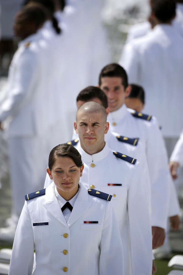First-year cadets proceed into the U.S. Coast Guard Academy's 134th Commencement Exercises before becoming newly commissioned ensigns, Wednesday, May 20, 2015, in New London, Conn. President Barack Obama delivered the commencement address speaking on global warming. (AP Photo/Stephan Savoia)