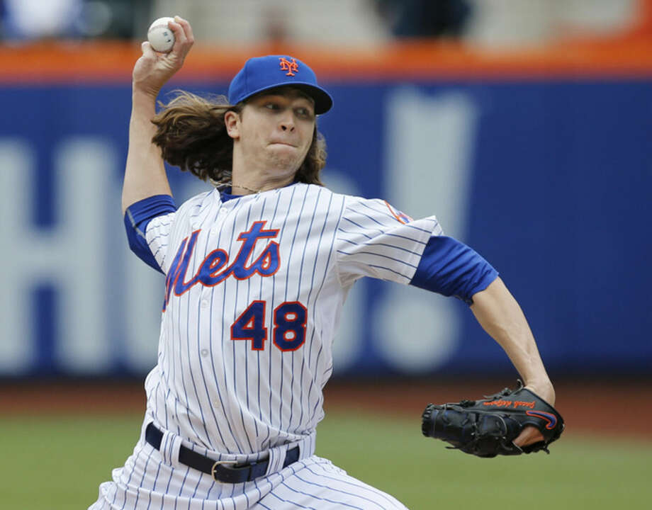 New York Mets starting pitcher Jacob deGrom (48) delivers in the first inning of a baseball game against the St. Louis Cardinals in New York, Thursday, May 21, 2015. (AP Photo/Kathy Willens)