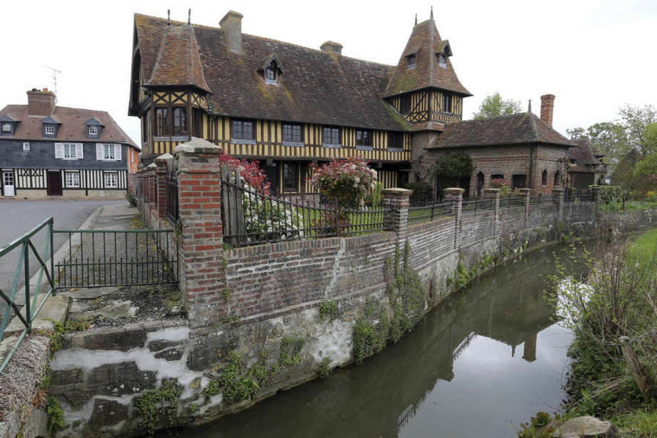 This April 24, 2014 photo shows a home in Beuvron en Auge, France, a typical small village in Normandy. Local officials estimate that several hundred thousand tourists will flock to Normandy this summer, attracted by the 70th anniversary of D-Day. (AP Photo/David Vincent)