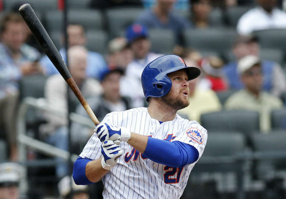 New York Mets' Lucas Duda watches his eighth-inning, three-run home run in a baseball game against the St. Louis Cardinals in New York, Thursday, May 21, 2015. (AP Photo/Kathy Willens)