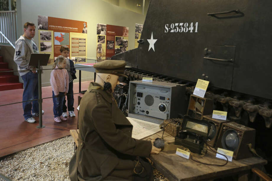 This April 24, 2014 photo shows tourists visiting the Battle of Normandy Memorial Museum, in Bayeux, France. Local officials estimate that several hundred thousand tourists will flock to Normandy this summer, attracted by the 70th anniversary of D-Day. (AP Photo/David Vincent)