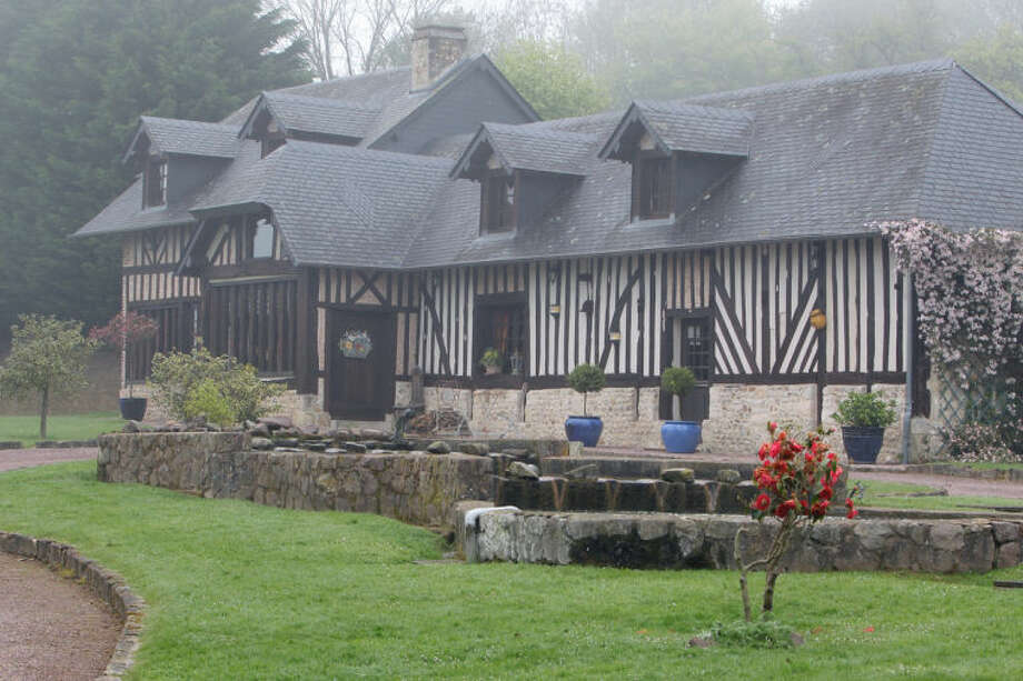 """This April 24, 2014 photo shows """"Le Manoir de Gefosse"""", a typical Normandy farm where Gustave Flaubert, author of classic French novel """"Madame Bovary"""" spent his childhood, in Pont L'Eveque, France. Local officials estimate that several hundred thousand tourists will flock to Normandy this summer, attracted by the 70th anniversary of D-Day. The commemorations culminate on June 6 in the port of Ouistreham, where U.S. President Barack Obama, French president Francois Hollande and Britain's Queen Elizabeth II will gather to remember the more than 9,000 Allied soldiers killed or wounded that day. (AP Photo/David Vincent)"""
