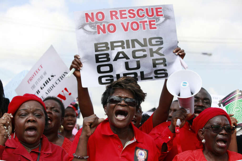 Women attend a demonstration calling on government to rescue kidnapped school girls of a government secondary school Chibok, in Lagos, Nigeria, Monday, May. 5, 2014, A leader of a protest march for 276 missing schoolgirls said that Nigeria's First Lady ordered her and another protest leader arrested Monday, expressed doubts there was any kidnapping and accused them of belonging to the Islamic insurgent group blamed for the abductions. Saratu Angus Ndirpaya of Chibok town said State Security Service agents drove her and protest leader Naomi Mutah Nyadar to a police station Monday. (AP Photo/ Sunday Alamba)
