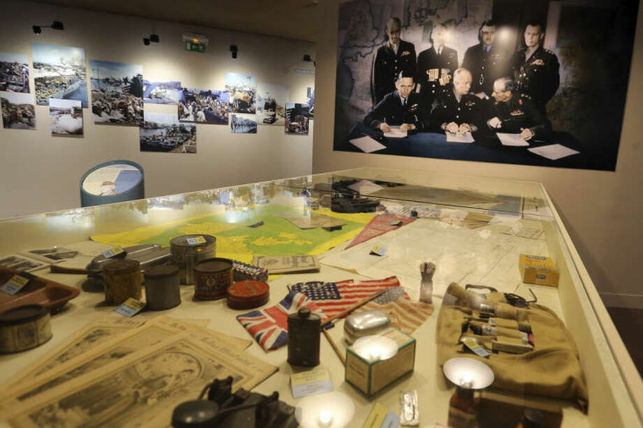 This April 24, 2014 photo shows a room with artifacts at the Battle of Normandy Memorial Museum in Bayeux, France. Local officials estimate that several hundred thousand tourists will flock to Normandy this summer, attracted by the 70th anniversary of D-Day. (AP Photo/David Vincent)