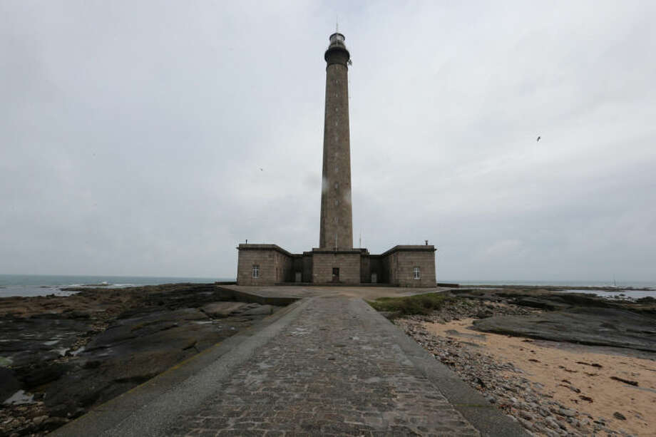This April 25, 2014 photo shows the Gatteville Lighthouse in Barfleur, western France. Local officials estimate that several hundred thousand tourists will flock to Normandy this summer, attracted by the 70th anniversary of D-Day. (AP Photo/David Vincent)