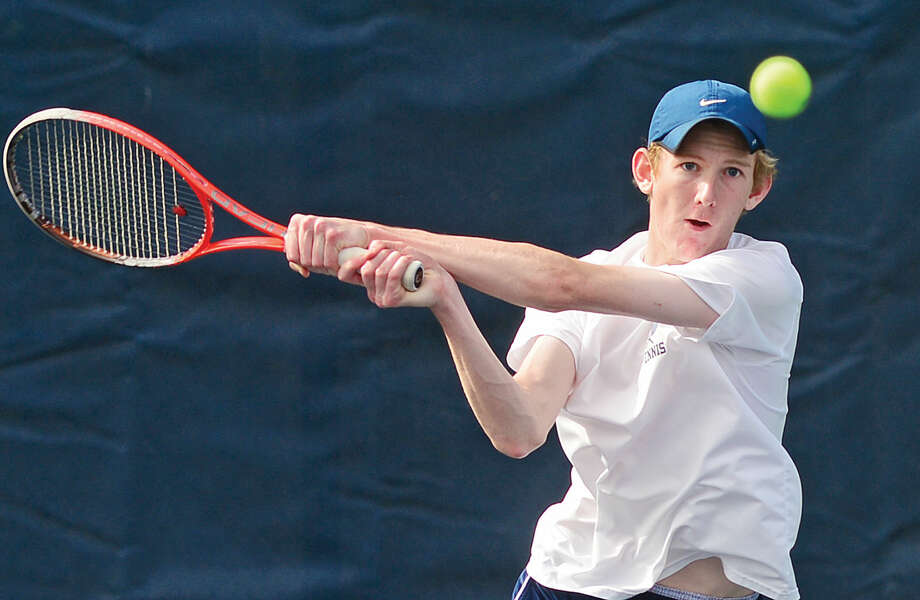 Hour photo / Erik Trautmann Wilton High School's #1 single Gerrit Gaillard plays Staples' Zack Levin during their FCIAC Boys Tennis final in Westport Thursday.