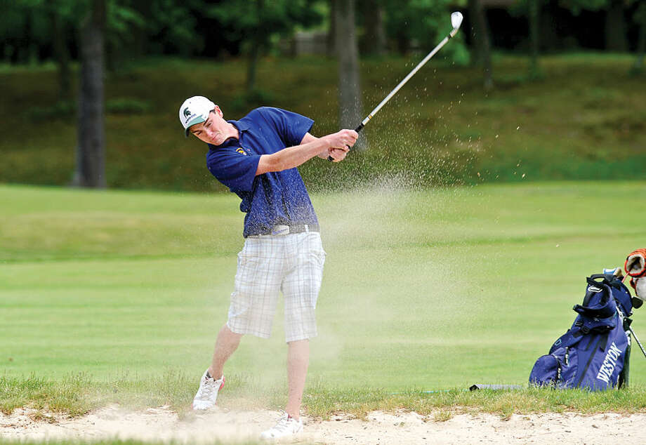 Hour photo / Erik Trautmann High School golfers including Weston's Brian Garvey compete in the annual Chappa Golf Tournament at Longshore Club Park in Westport Thursday