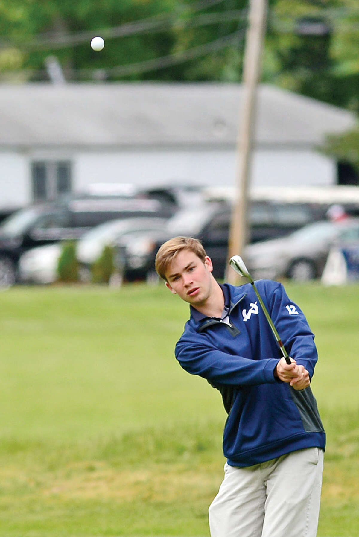 Hour photo / Erik Trautmann High School golfers including Wilton's Richie Williams compete in the annual Chappa Golf Tournament at Longshore Club Park in Westport Thursday