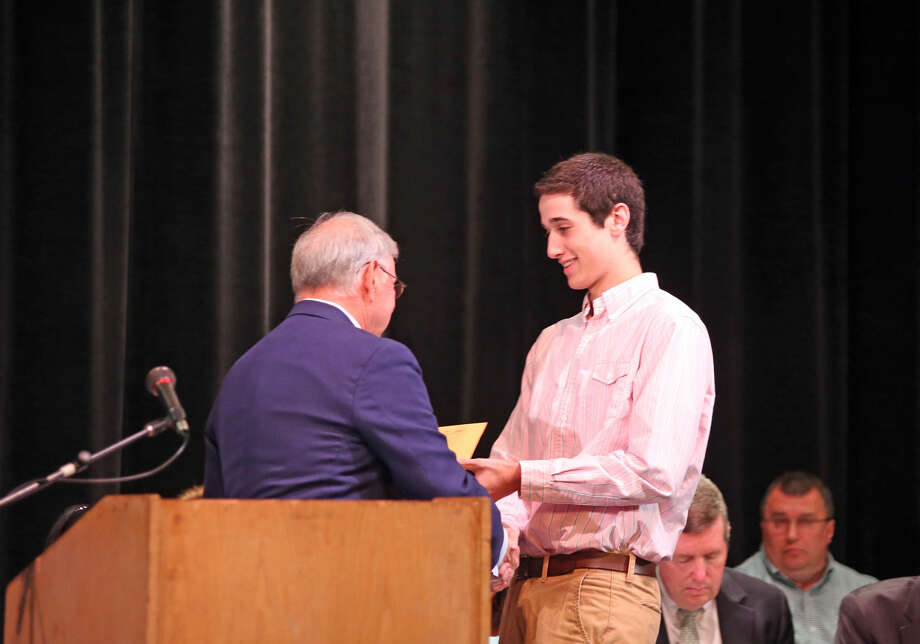 Robert Butler accepts The Naramake Scholarship during Norwalk High School's Awards Program Thursday evening. Hour Photo / Danielle Calloway