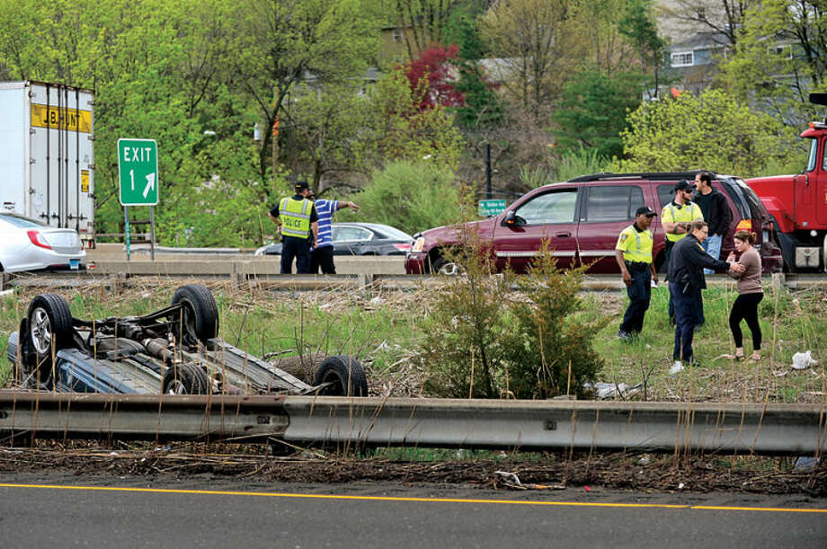 Hour photo / Erik Trautmann Emergency personnel respond to the scene of a rollover on the route 7 connector Southbound Tuesday afternoon.