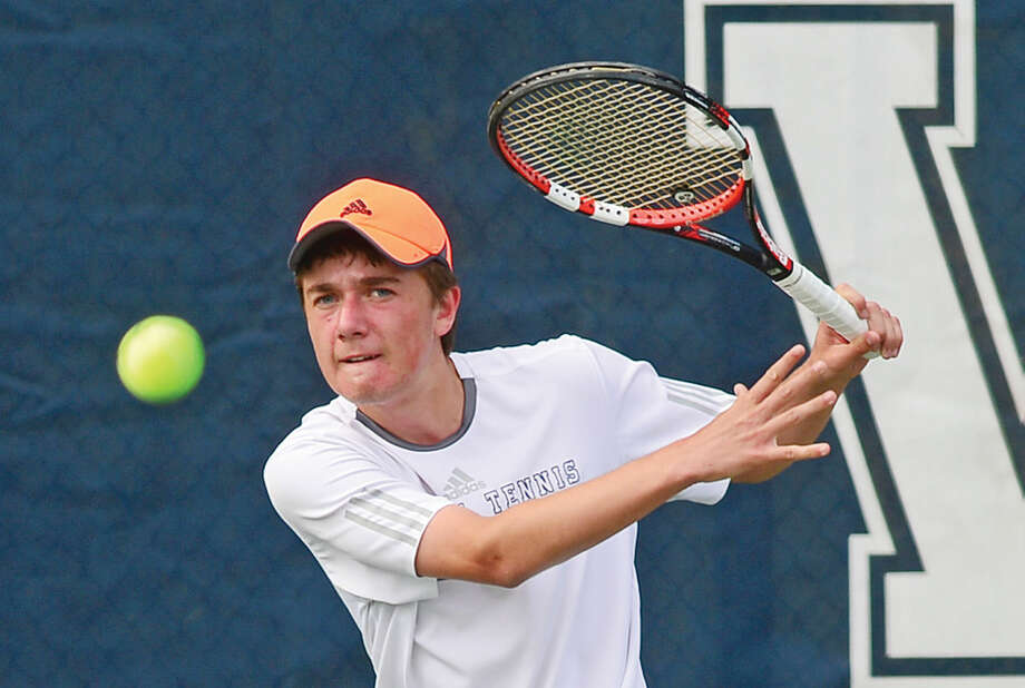 Hour photo / Erik Trautmann Staples High School's #2 single Will Andrews plays Wilton's Ian Erickson during their FCIAC Boys Tennis final in Westport Thursday.