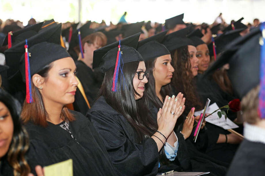 Vanessa Funicella applauds during Norwalk Community College's 53rd Annual Commencement Exercises Thursday afternoon. Hour Photo / Danielle Calloway